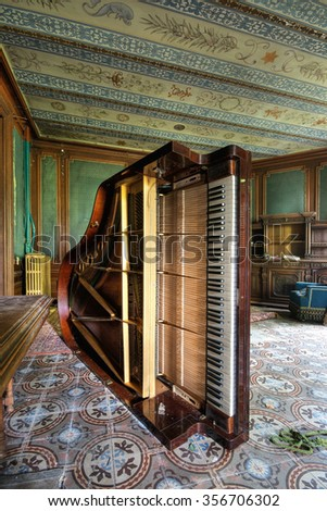 France - July 22.2012: destroyed piano by vandalism in an abandoned mansion.