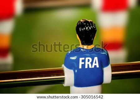 France National Jersey on Vintage Foosball, Table Soccer or Football Kicker Game, Selective Focus, Retro Tone Effect - stock photo