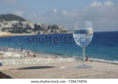 France, Nice, Cote d'Azur. Panoramic view of the beach on a sunny day. The reflection in the glass.