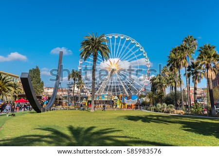 FRANCE, NICE - FEBRUARY 19: Big carnival fair wheel on the Place Massena in Nice, France on February 19, 2017