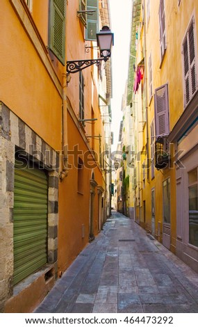 FRANCE. Old town architecture of Nice on French Riviera. Narrow street in Nice city one of the most visited in France tourist