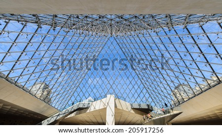 FRANCE, PARIS - APRIL 14: Interior of the Louvre Pyramid, April 14, 20013 in Paris, France. The pyramid structure was engineered by Nicolet Chartrand Knoll and Rice Francis Ritchie