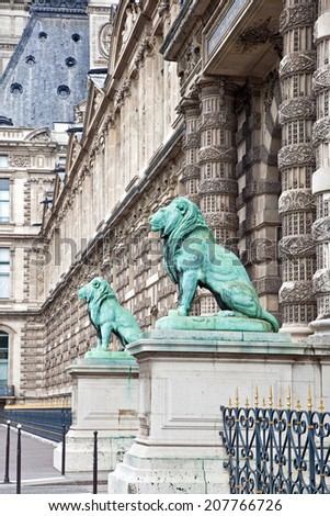 FRANCE, PARIS - April 29.2014: Sculptures of lions near a famous art gallery Louvre