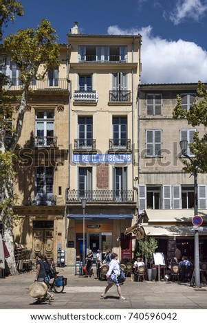 France, Provence, Aix-en-Provence - August 11: Street scene Cours Mirabeau with citizen, tourists, trees, shops, restaurants and houses in the city center, August 11, 2017