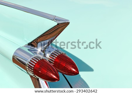 FRANCE - SEPTEMBER 1, 2013: Classic car tail rocket lights on american old timer - stock photo