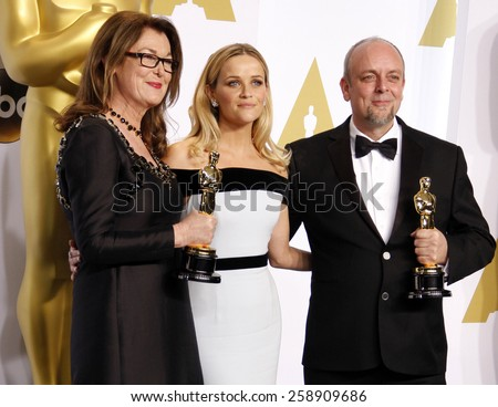 Frances Hannon, Mark Coulier and Reese Witherspoon pose in the press room during the 87th Annual Academy Awards at Loews Hollywood Hotel on February 22, 2015 in Hollywood, California.