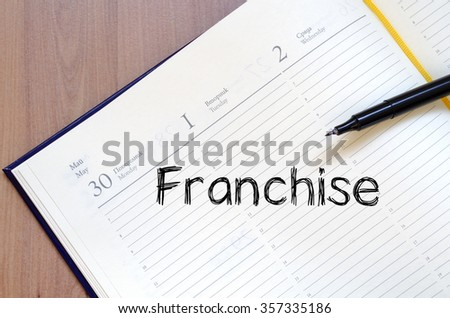 Franchise text concept write on notebook with pen