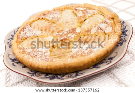 Frangipane tart made with pears and almonds - stock photo