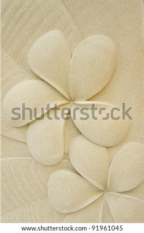 Frangipani flower motifs on the walls, plaster, natural color.