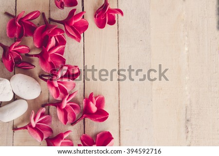 Frangipani flowers red and stones . spa concept for background .