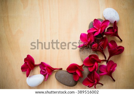 Frangipani flowers red , white and stones . spa concept - stock photo