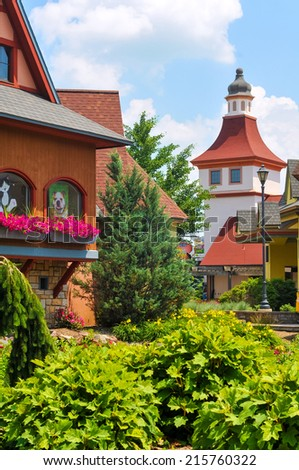 FRANKENMUTH, MI - JUNE 28, 2014: German-style architecture forms the backdrop of River Place, a new collection of shops and attractions in this Michigan town known best for Christmas and German food. - stock photo