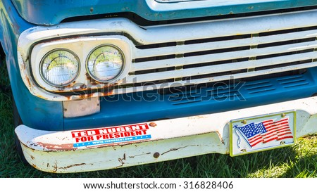 """FRANKENMUTH, MI/USA - SEPTEMBER 13, 2015: """"Ted Nugent For President"""" on a 1959 Ford truck at the Frankenmuth Auto Fest. Nugent is a political activist and former guitarist for the """"The Amboy Dukes"""". - stock photo"""