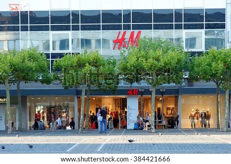 FRANKFURT AM MAIN, GERMANY - AUGUST 7, 2015: HM store on the famous Zeil shopping street. H&M is a Swedish multinational retail-clothing company. - stock photo