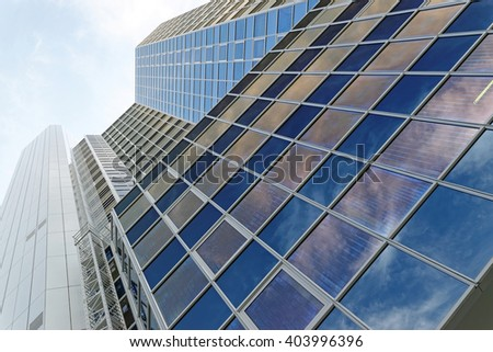 FRANKFURT AM MAIN, GERMANY - AUGUST 7, 2015: Office building on Neue Mainzer Str. shot at a angle perspective. - stock photo