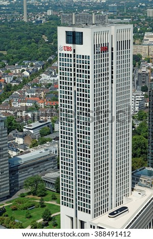 FRANKFURT AM MAIN, GERMANY- AUGUST 6, 2015: Opernturm (Opera Tower) skyscraper with UBS logo. UBS is a Swiss global financial services company headquartered in Zurich, Switzerland. - stock photo