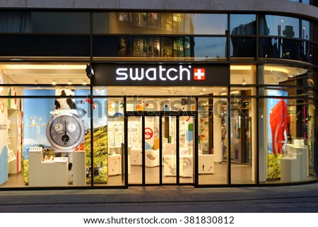 FRANKFURT AM MAIN, GERMANY - AUGUST 7, 2015: Swatch store on Zeil, at night. Swatch SA, founded in 1983, is specialized in watch manufacturing and one of the biggest brand names in the world. - stock photo