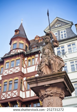 FRANKFURT AM MAIN, GERMANY - FEBRUARY 6, 2015: photo of statue in Romerplatz, Romer old part of Frankfurt am Main city, Germany. Photo taken on February 6, 2015  - stock photo