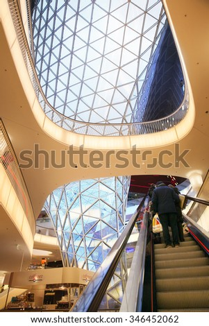 FRANKFURT AM MAIN, GERMANY - JAN 10, 2015: People on escalator in the My Zeil shopping centre. It's been designed by Massimiliano Fuksas. - stock photo