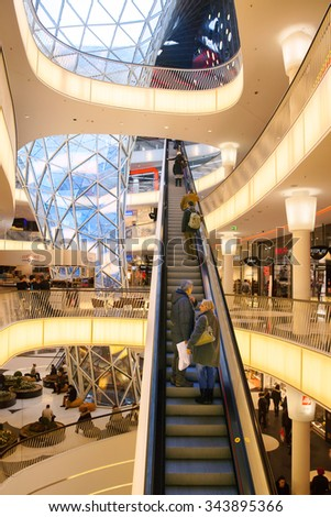 FRANKFURT AM MAIN, GERMANY - JAN 11, 2015: The escalator in the shopping centre MyZeil is located on the Zeil shopping boulevard. It's been designed by Massimiliano Fuksas. - stock photo