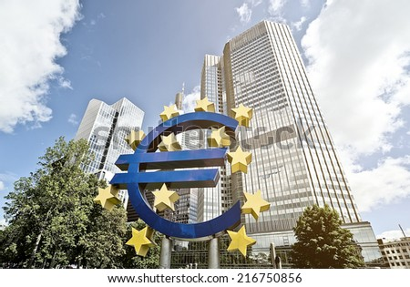 FRANKFURT AM MAIN, GERMANY -  MAY 14, 2014: Euro sign in front of the European Central Bank (Europaeische Zentral Bank) headquarter building - stock photo