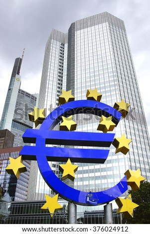 FRANKFURT AM MAIN- SEPTEMBER 25, 2012: The Famous Big Euro Sign at the European Central Bank. The bank was established by the Treaty of Amsterdam in 1998.  - stock photo