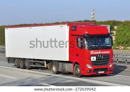 FRANKFURT,GERMANY-APRIL 10:Mercedes Benz truck on the highway on April 10,2015 in Frankfurt,Germany.MB is a German automobile manufacturer. - stock photo