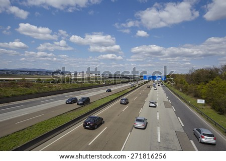 FRANKFURT, GERMANY - APRIL, 18. The federal Autobahn A5 beneath the Airport of Frankfurt (Germany) in direction to the Frankfurt Kreuz with a road sign to the airport taken on April 18, 2015. - stock photo