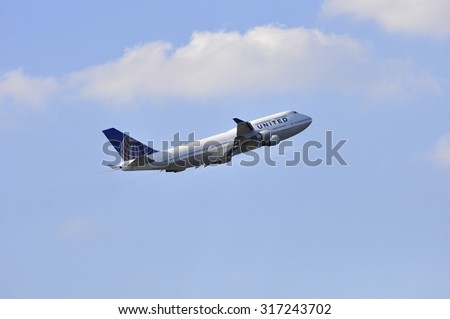 FRANKFURT,GERMANY-AUG 21:airplane of United Airlines above the Frankfurt airport on August 21,2015 in Frankfurt,Germany.United is a major American airline carrier headquartered in Chicago, Illinois.