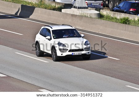 FRANKFURT,GERMANY-AUGUST 21: Porsche on the highway on August 21,2015 in Frankfurt,Germany.Porsche AG, is a German automobile manufacturer specializing in high-performance sports cars, SUVs and sedans - stock photo