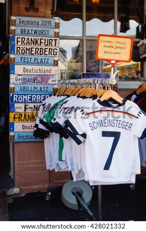 FRANKFURT, GERMANY- AUGUST 22, 2015 : T-shirts for sale in a souvenir in Frankfurt, Germany. - stock photo