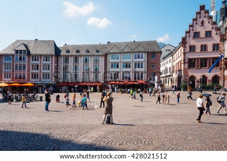 FRANKFURT, GERMANY- AUGUST 22 , 2015: Tourists walking and enjoying the center of the old city of Frankfurt, Germany. - stock photo