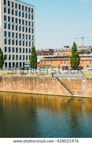 FRANKFURT, GERMANY- AUGUST 22 , 2015: View of an office building and the Main river , Frankfurt. - stock photo