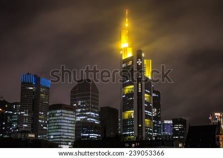 FRANKFURT, GERMANY - CIRCA DECEMBER 2014: Evening photo of Frankfurt Skyline and Commerzbank tower in cloudy weather at night - architecture background