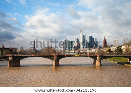 FRANKFURT, GERMANY - JAN 11, 2015:  Mine river against skyscrapers of Frankfurt's downtown in cold day