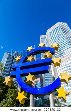 FRANKFURT, GERMANY - JULY 9: Euro sign. European Central Bank headquarters in Frankfurt in Germany in summer day on July 9, 2014 in Frankfurt, Germany.