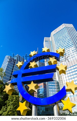 FRANKFURT, GERMANY - JULY 9: Euro sign. European Central Bank headquarters in Frankfurt in Germany  in summer day on July 9, 2014