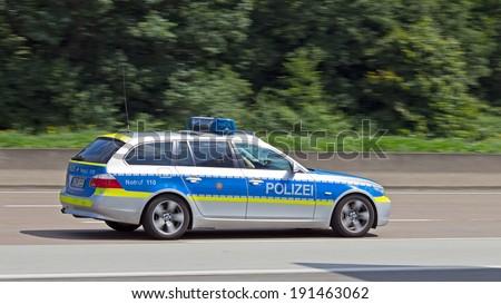 FRANKFURT, GERMANY - JULY 11: German police car on the german autobahn on July 11, 2013 near Frankfurt, Germany. - stock photo
