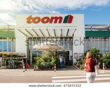 Frankfurt germany jun 30 2017 toom stock photo 673655320 shutterstock frankfurt germany jun 30 2017 woman walking to the entrance of toom solutioingenieria Gallery