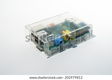 Frankfurt, Germany - June 16, 2014: Shot of a Raspberry Pi in transparent case on white.