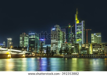 FRANKFURT, GERMANY - MAR 17, 2016: Illuminated buildings and skyline at night during Luminale  in Frankfurt, Germany. The Light festival takes place in Frankfurt every 2 years and lasts one week. - stock photo