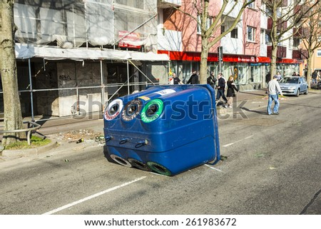 FRANKFURT, GERMANY - MAR 18, 2015: people demonstrate against EZB and Capitalism in Frankfurt, Germany. Some people destroy windows and objects at the street are burning. - stock photo