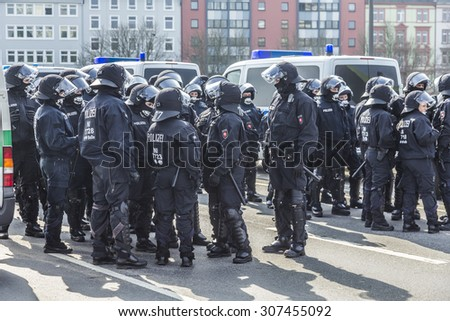 FRANKFURT, GERMANY - MAR 18, 2015: police pays attention for people demonstrate against EZB and Capitalism in Frankfurt, Germany. 9 tsd policemen guard the demo.