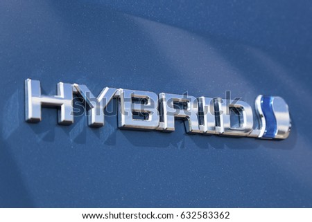 Frankfurt, Germany - March 30, 2017: Logo of a Toyota hybrid car. Toyota is the world's leader in sales of hybrid vehicles.