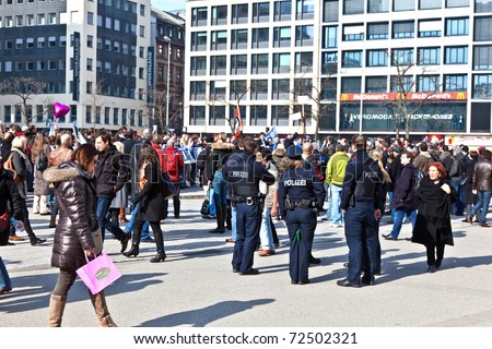 FRANKFURT, GERMANY - MARCH 5: People demonstrate for return of Karl Theodor zu Guttenberg into politics on March 05, 2010 in Frankfurt, Germany. Guttenberg resigned from his job due to a faked dissertation.