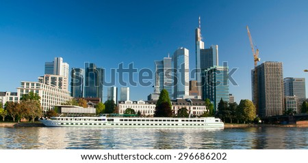 FRANKFURT,GERMANY 5 MAY 2015: Headquarter of Commerzbank with luxury ship on the river - stock photo