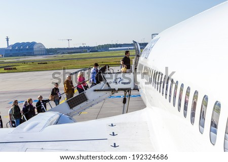 FRANKFURT, GERMANY - MAY 4: people board the Lufthansa aircraft on May 4, 2014 in Frankfurt, Germany. Frankfurt is  the busiest airport in Germany and one of the busiest in Europe.
