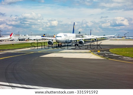 Frankfurt, Germany - May 30, 2013: Runway with several airplanes waiting for clearance to take off.  The Frankfurt International Airport is the largest in Germany and the third largest in Europe.