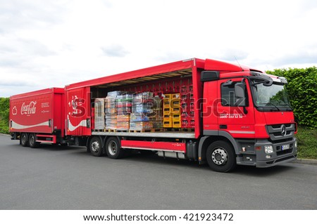 FRANKFURT,GERMANY-MAY 17: truck of Coca Cola  on May 17,2016 in Frankfurt,Germany.Coca-Cola-carbonated soft drink and it is produced by The Coca-Cola Company of Atlanta, Georgia in the United States.