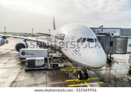 FRANKFURT, GERMANY - OCT 20, 2015: Lufthansa Airbus A380 at the Gate of the Frankfurt Airport.  the A380 covers also the connection FRA to NYC by Lufthansa. - stock photo